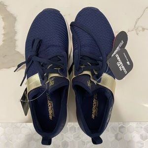 Navy and gold New Balance sneakers